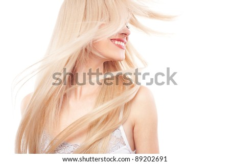 Portrait of beautiful woman with long blond hair over white