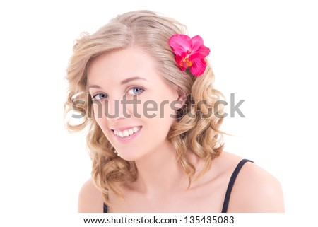 portrait of beautiful woman with pink orchid in her hair