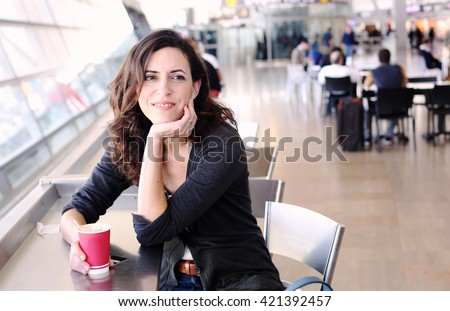Portrait of beautiful 40 years old woman holding cup of coffee