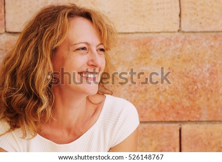 Portrait of beautiful 40 years old woman outdoors
