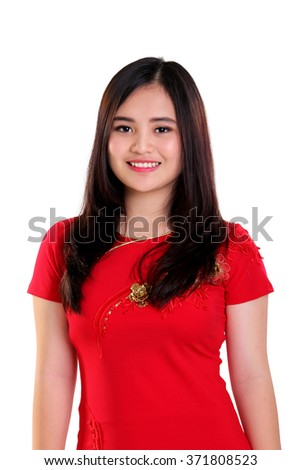 Portrait of beautiful young Asian woman wearing red cheongsam dress smiling, isolated on white background