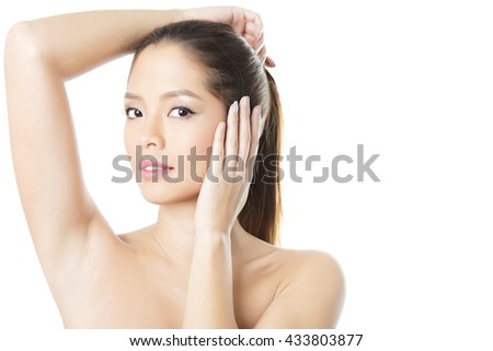 portrait of beautiful young asian woman with clear skin isolated on white