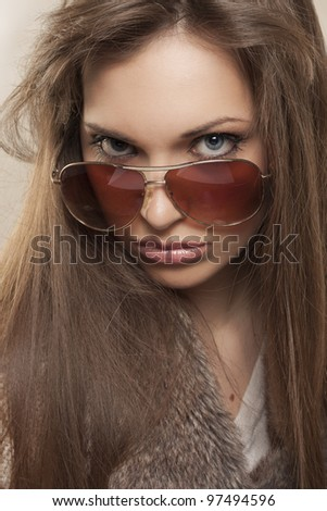 Portrait of beautiful young girl with sunglasses