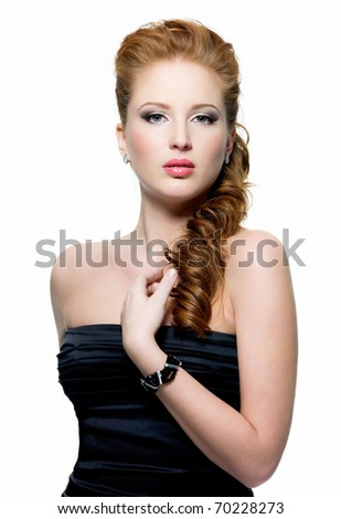 Portrait of beautiful young red-haired woman with fashion make-up on white background