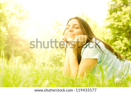 Portrait of beauty girl relaxing in nature.