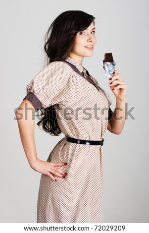 portrait of beauty young woman with chocolate