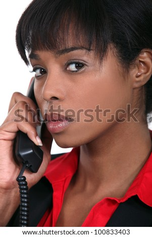 portrait of black businesswoman on the phone