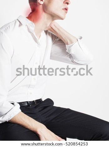 portrait of body part businessman isolated on white background pain killers holding neck hurts, modern real business concept