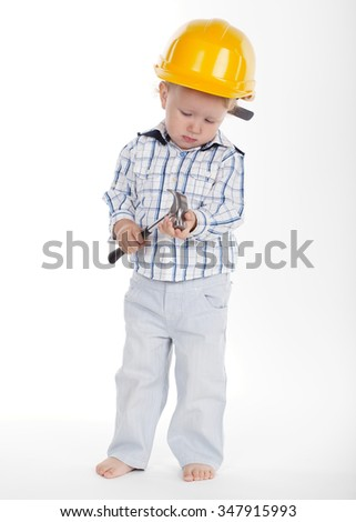 Portrait of boy in protective helmet and hammer
