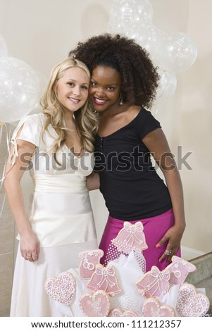 Portrait of bride and friend at  party