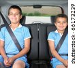 Portrait of brothers wearing seatbelts - stock photo