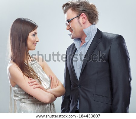 Portrait of business couple. Funny people isolated on gray.