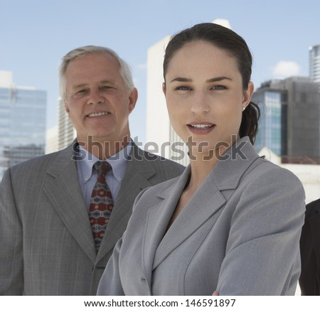 Portrait of businesswoman and businessman