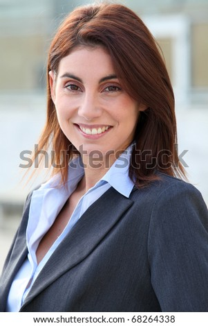 Portrait of businesswoman standing outside