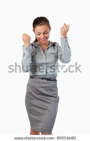 Portrait of businesswoman with the fists up against a white background