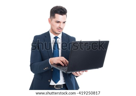 Portrait of casual businessman typing email on laptop as modern communication concept isolated on white