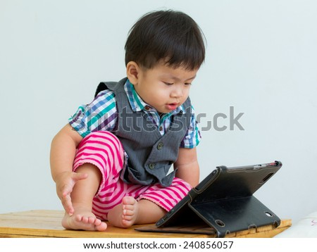 Portrait of child on table in a digital tablet