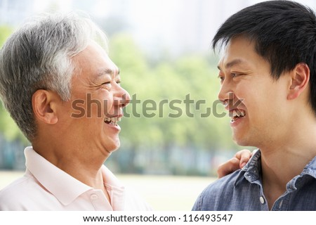 Portrait Of Chinese Father With Adult Son In Park