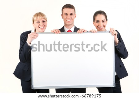 Portrait of confident business people holding whiteboard and looking at camera