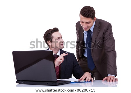 Portrait of confident businessman sharing ideas with his partner