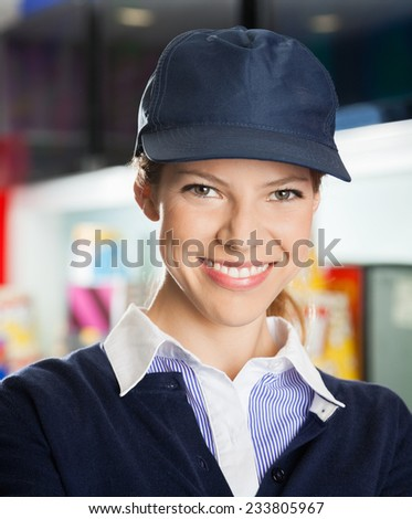 Portrait of confident female concession worker at cinema