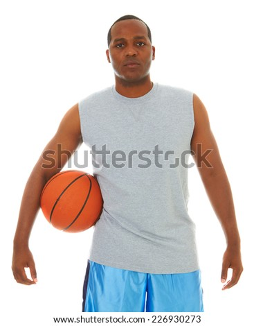 Portrait of confident young male African American athlete with basketball standing over white background