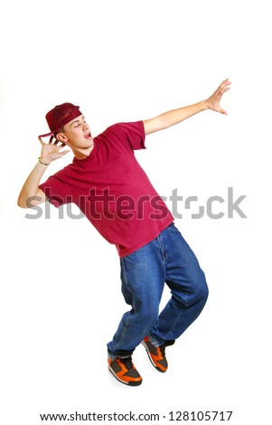Portrait of cool young breakdancer posing isolated on white background