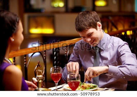 Portrait of couple eating dish in the restaurant