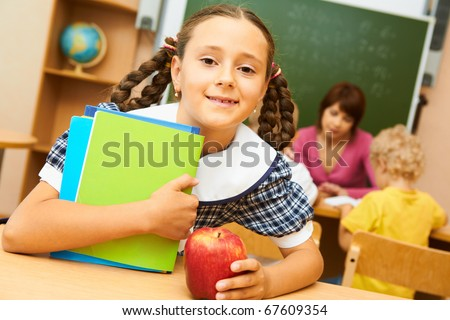 Portrait of cute girl looking at camera during lesson