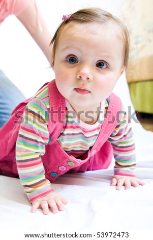 Portrait of cute little baby girl crawling on the floor