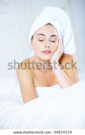 Portrait of cute teenage girl wearing towel on her head