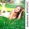 portrait of cute young teenage girl relaxing in spring park - stock photo
