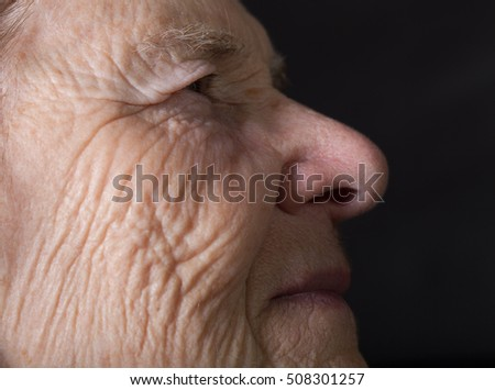Portrait of elderly woman. Dreaminess.