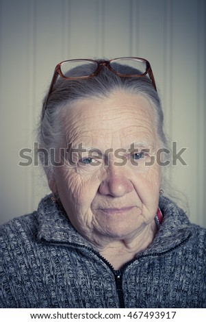 Portrait of elderly woman in glasses. Toned.