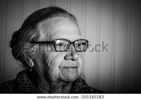 Portrait of elderly woman with glasses. Toned.