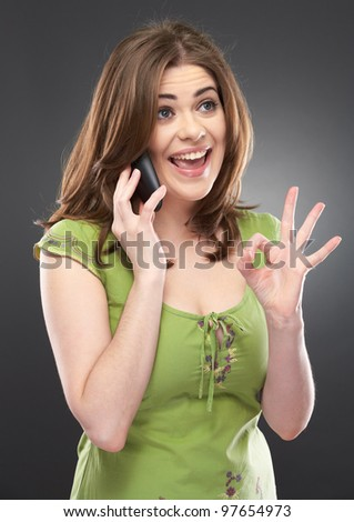 Portrait of emotional woman speaking on the phone, Isolated on gray background, casual stule dressed