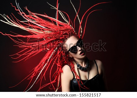 Portrait of expressive girl with great red dreadlocks. - stock photo
