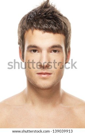 Portrait of face of young beautiful man close up, on white background.