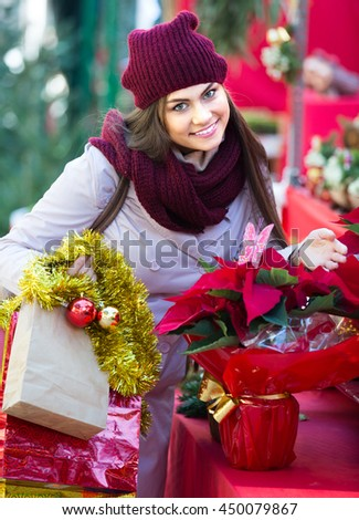Portrait of female customer choosing eucalyptus decorations for Christmas