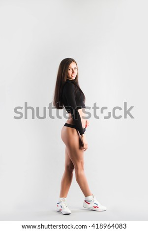 Portrait of fit young women in sports clothing standing. Motivation.