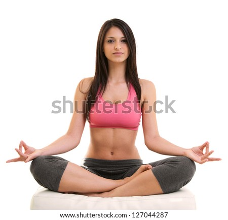 Portrait Of Fitness Young Woman Sitting Cross Legged In Lotus Position