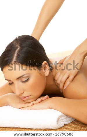 Portrait of Fresh and Beautiful brunette woman taking massage