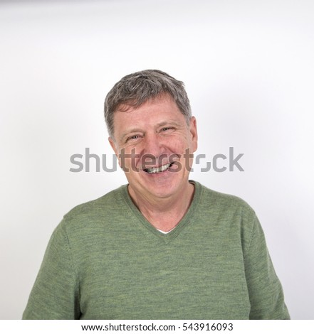 portrait of friendly happy laughing mature man