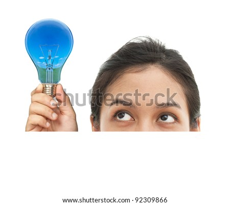 Portrait of funny face girl look at the bulb. Blank space for text on isolated white background