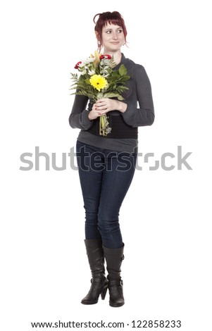 Portrait of gorgeous woman holding flowers against white background
