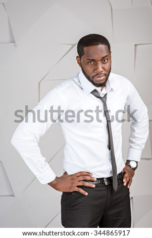 Portrait of handsome afro american businessman. Young stylish businessman looking at camera. Man wearing tie