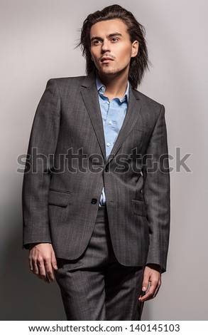 Portrait of handsome long-haired stylish man.