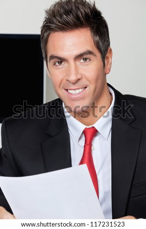 Portrait of handsome young businessman at office