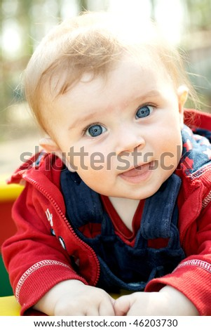 portrait of happy baby in park
