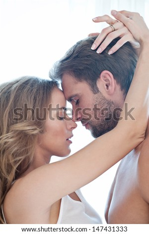 Portrait of happy beautiful couple isolated on white - portrait - caucasian